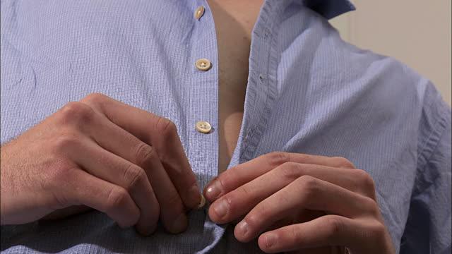 Buttoning a shirt