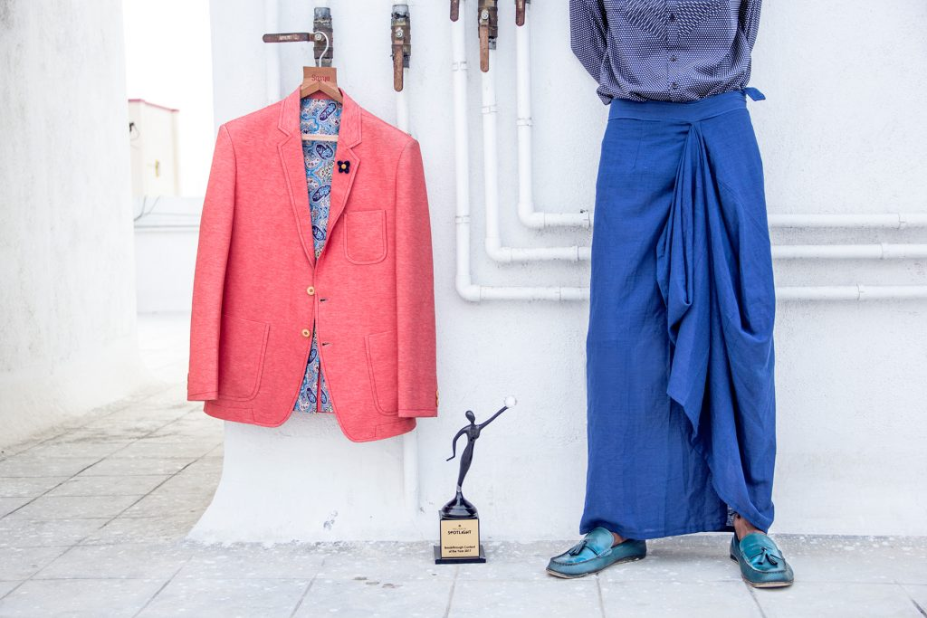 Coral blazer jacket by Sasya Blue lungi by Purushu Arie