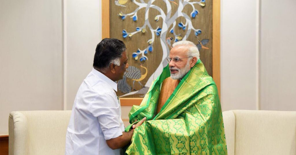 Former Tamil Nadu Chief Minister O. Panneerselvam felicitating Prime Minister Narendra Modi with ponnadai.
